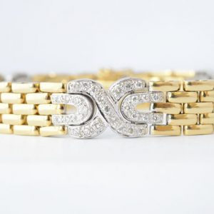 Gouden diamanten armband cartier stijl