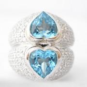 hartvormige ring met diamant en topaas