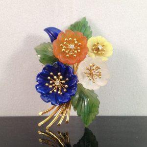 Bloemen broche met edelsteen en diamant