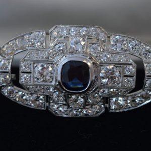Broche bezaaid met diamant en saffier