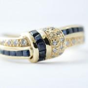 Designring bezet met saffier en diamant
