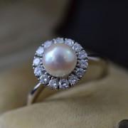 Entourage ring met parel en diamant